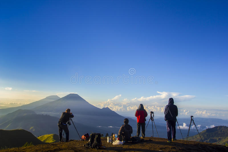 Nature photographer in action during sunrise stock photography
