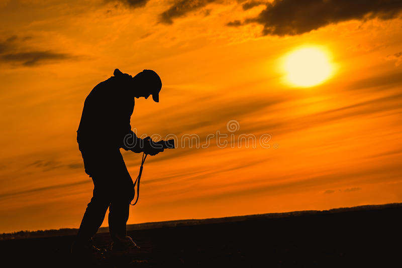 Nature photographer silhouette the sunset stock images