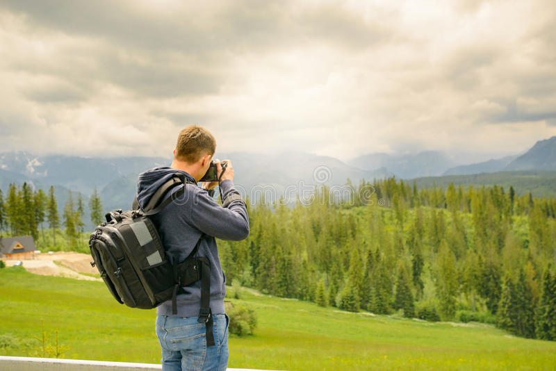 Nature photographer taking photos in the mountains royalty free stock images