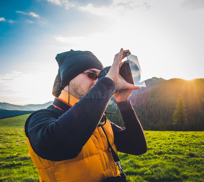 Nature photographer tourist in mountains stock photo
