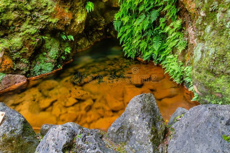 Nature rich in thermal waters, minerals and strong colors flow f royalty free stock photography