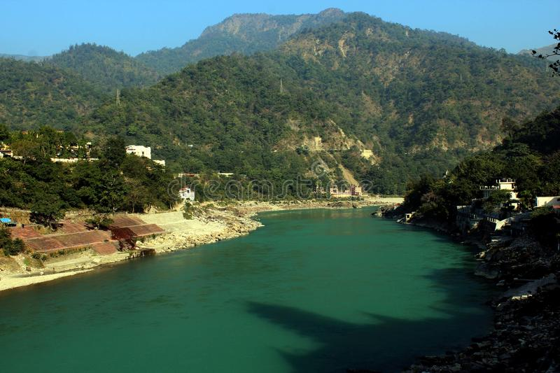 Nature Rishikesh. Rishikesh. Rishikesh, a most tranquil place in northern Uttarakhand, surrounded by hills and bisected by the wide and sluggish Ganges, is often stock image