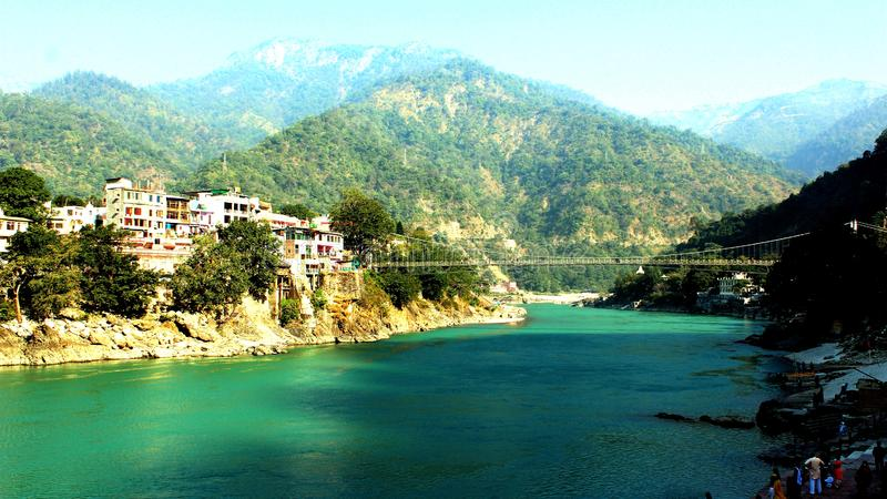 Nature Rishikesh. Rishikesh. Rishikesh, a most tranquil place in northern Uttarakhand, surrounded by hills and bisected by the wide and sluggish Ganges, is often stock photo