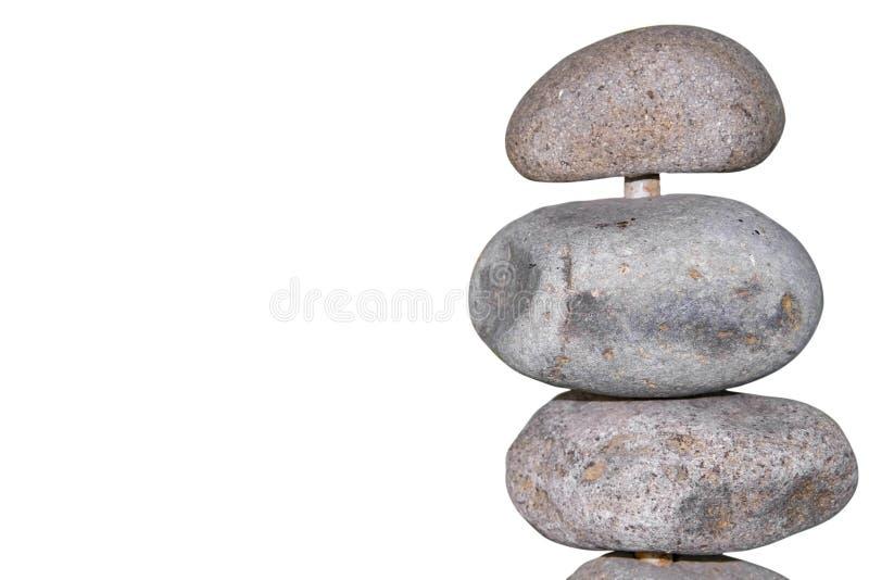 Nature - roches sur un plan rapproché de poteau au côté de l'image d'isolement sur le fond blanc - pièce pour la copie image libre de droits