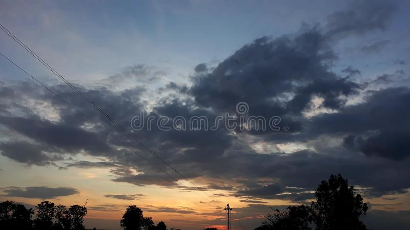 Nature& x27;s glory. The sky takes on shades of orange during sunrise and sunset, the colour that gives you hope that the sun will set only to rise again royalty free stock images