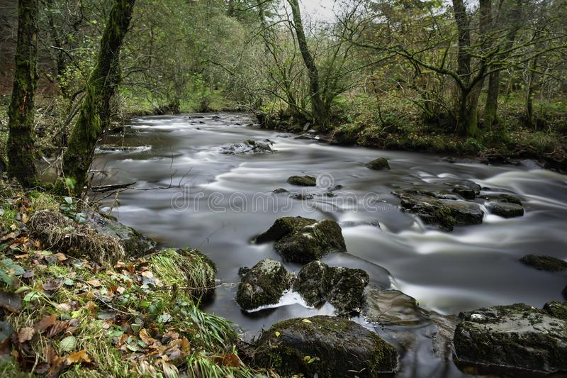 River Running Wild. Nature scene River Running Wild,within the beautiful surrounds of the Brecon Beacons National Park, Mid-Wales, United Kingdom. A Long royalty free stock photography