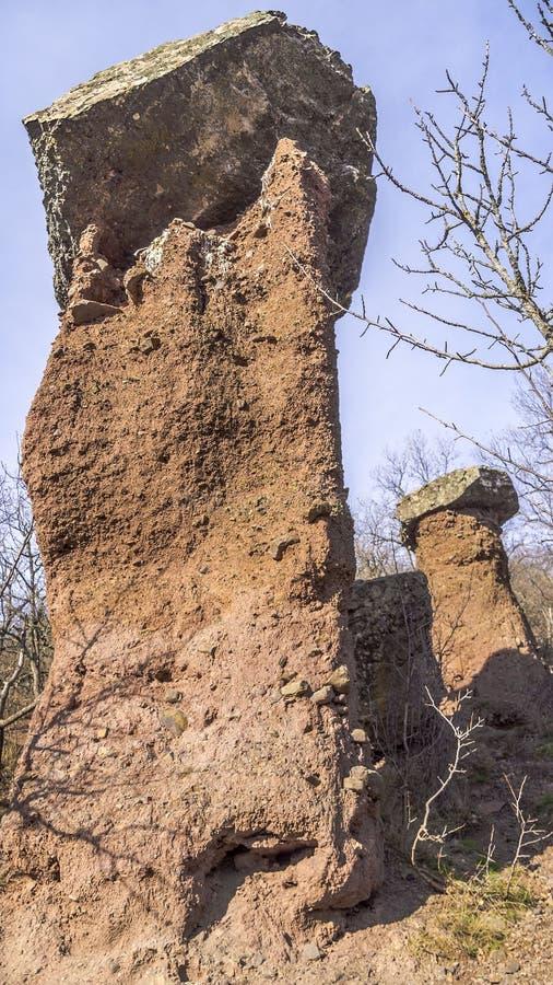 Nature is sculpturing weird huge stone mushrooms stock photos