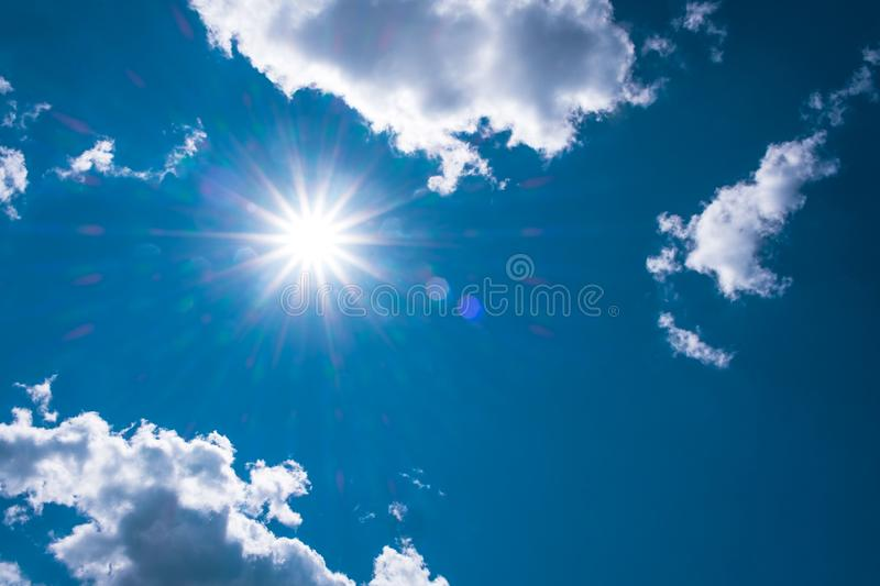 Nature Sun light radiation of lens fare with spectrum for background, backdrop, template & wallpaper. The bright sun shines on a b. Lue sky background, Copy royalty free stock photography