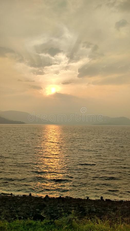 Nature and sunset water. Nature`s mode  Mount water sunset other stock images