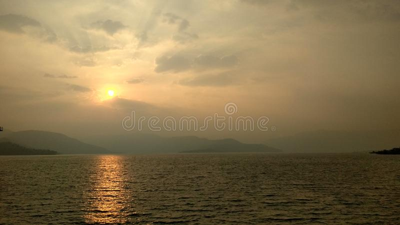 Nature and sunset water. Nature`s mode  Mount water sunset other stock image