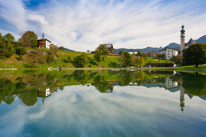 Nature swimming pool in Reith, Austria. Reflection on the nature swimming pool in Reith, Alpbachtal in Tyrol, Austria stock photography