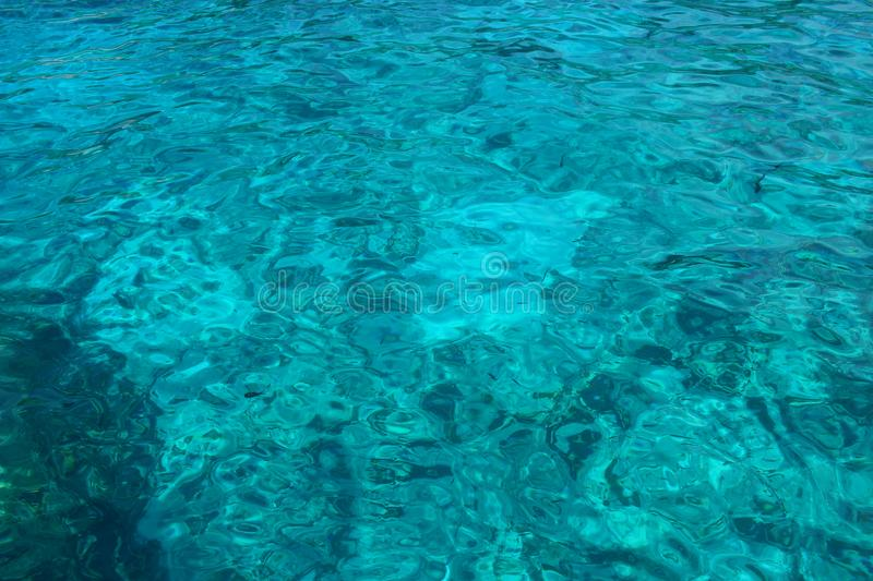 Texture of transparent turquoise sea water royalty free stock photo