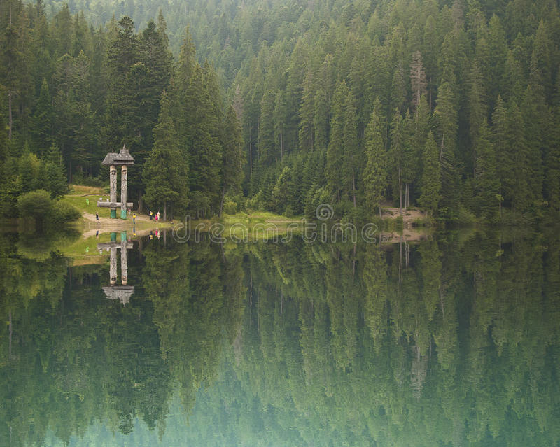 Nature tourist destination. A fir forest tourist destination with a lake reflection royalty free stock images