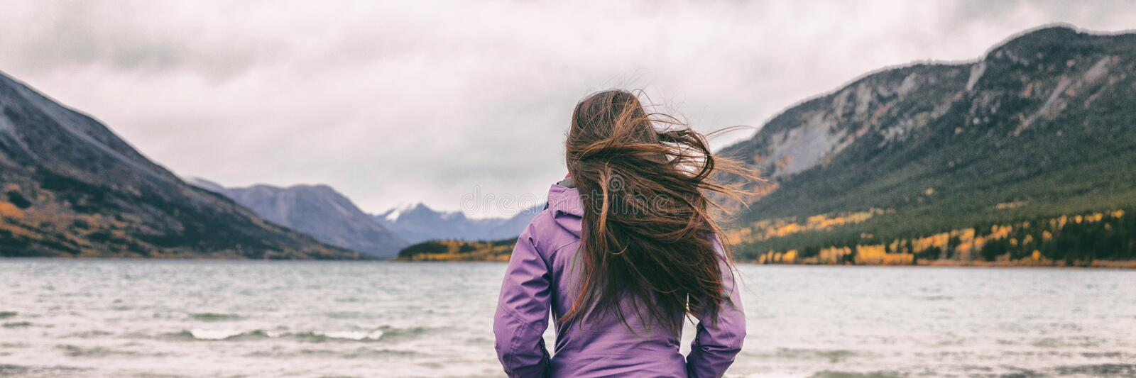 Nature travel panoramic banner woman hiker adventure wanderlust in Yukon travel tourist walking on beach in Carcross. Canada stock photos