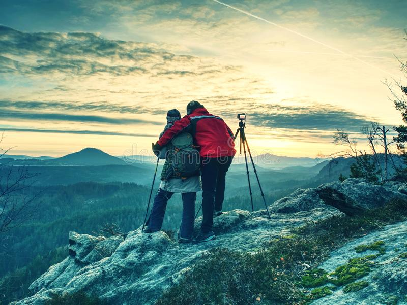 Nature photographers in red and light jacket take photo royalty free stock photography