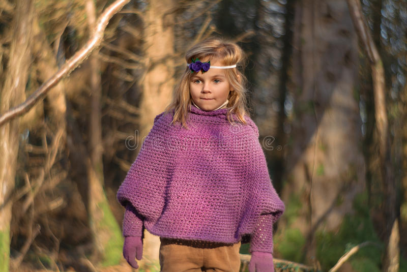 Nature Walk. A little girl out for a walk in autumn royalty free stock photography