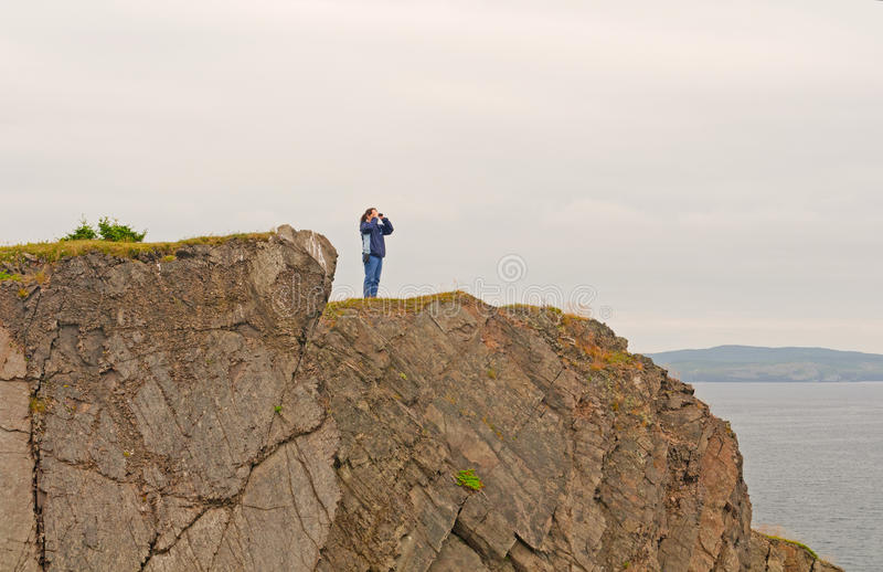 Nature watcher on a coastal cliff royalty free stock photography