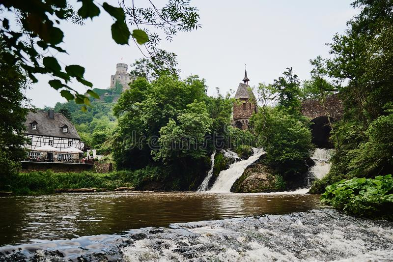Nature, waterfall and view of medieval burg. Tower and bridge royalty free stock photography