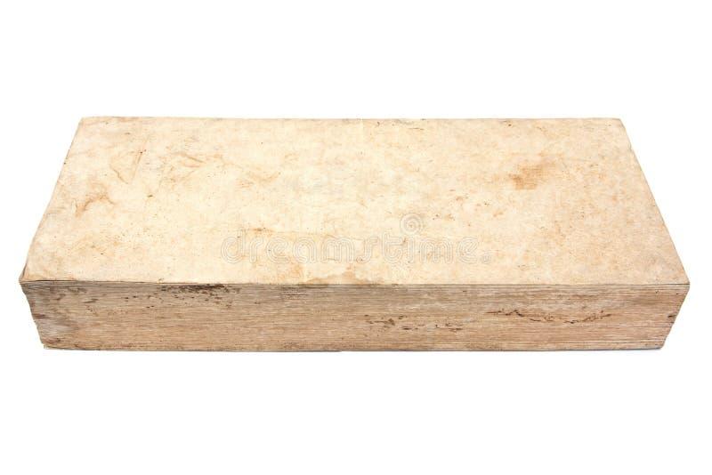Naturlig gammal bok som isoleras på vit bakgrund arkivfoto