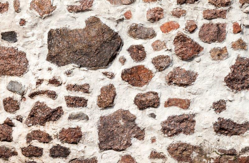 Naturlig gammal stenvägg som bakgrund arkivfoto