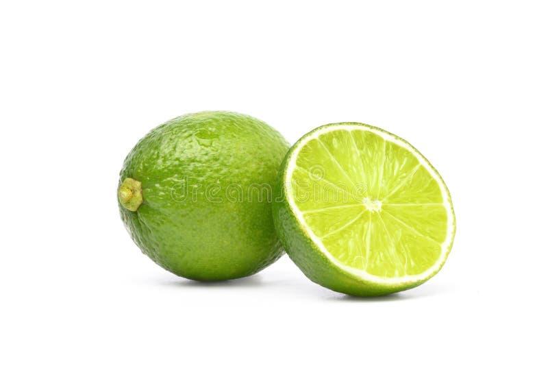 Naturlig ny limefrukt med snittet i halva arkivbild