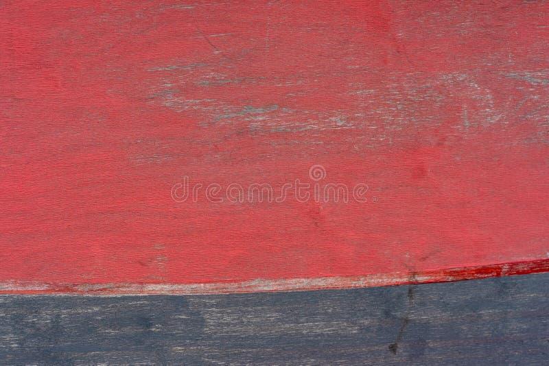 Naturlig trätextur för foto som målas i rött och blått arkivfoto