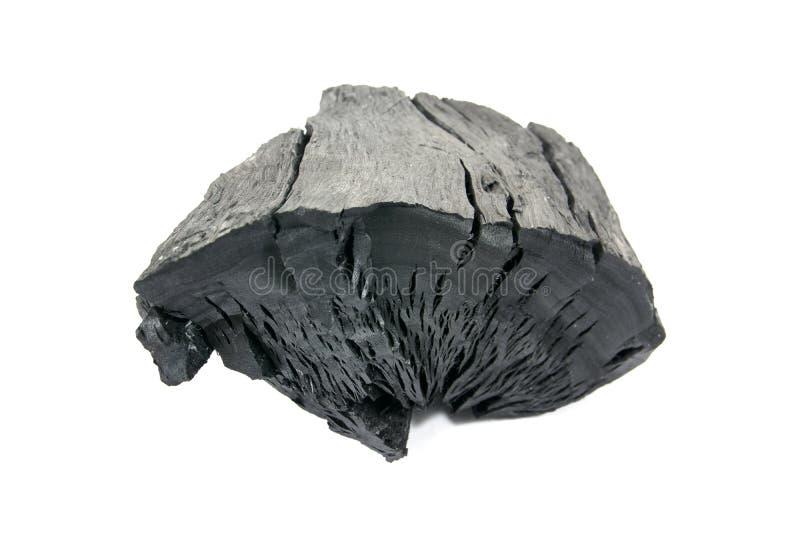 Naturligt wood kol som isoleras p? vit bakgrund Isolerade traditionellt kol eller h?rt tr? isolerat kol Koltextur royaltyfri fotografi