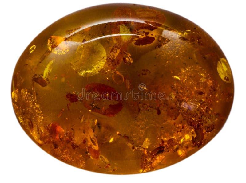 Natuurlijke cabochon van glanzende kunstmatige ambermacro royalty-vrije stock fotografie