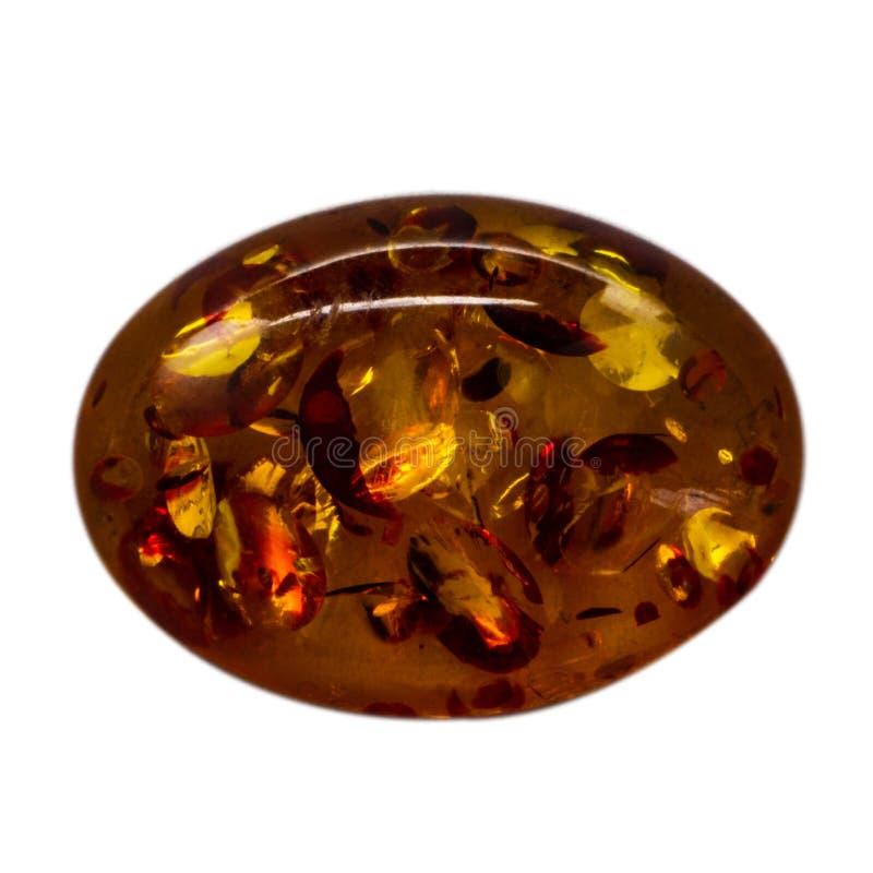 Natuurlijke cabochon van glanzende kunstmatige ambermacro royalty-vrije stock foto's
