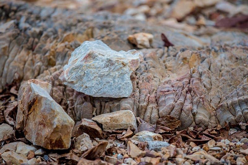 Natuurlijke de textuurachtergrond van de zandsteen Zand op het strand als achtergrond De concrete textuur van de kunstroom voor a stock afbeelding