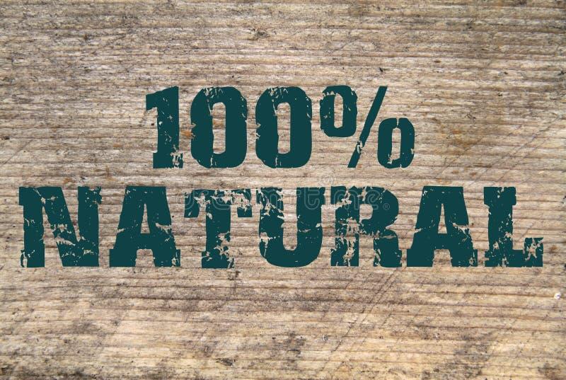 100% Natuurlijke gestempelde tekst op oude plank royalty-vrije stock afbeelding