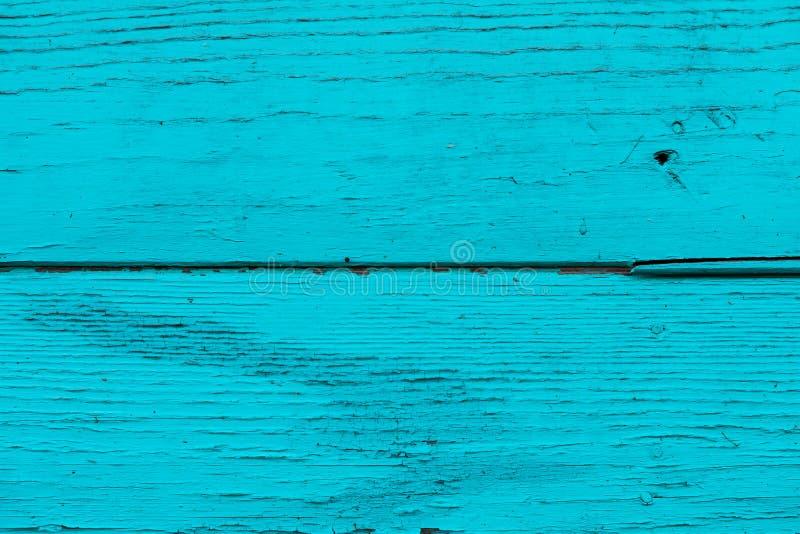 Natuurlijke houten blauwe, turkooise raad, muur of omheining met knopen Abstracte geweven achtergrond Geschilderde houten horizon royalty-vrije stock foto's