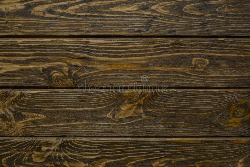 Natuurlijke houten raadstextuur van donkere bruine kleur royalty-vrije stock fotografie