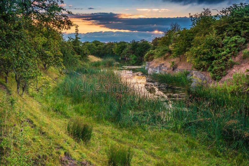 Natuurreservaat bij Niet meer gebruikte Littlemill-Steengroeve stock foto