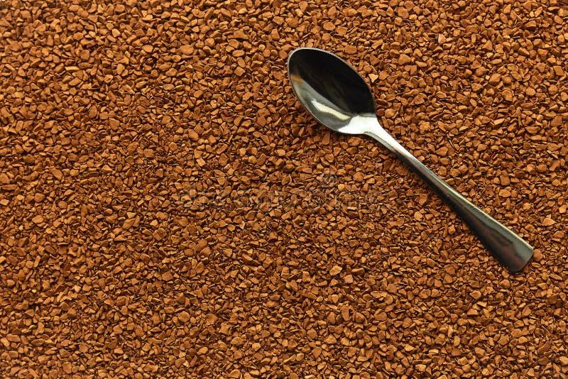 Natychmiastowej kawy tekstura, stalowa łyżka, aromatyczny napój zdjęcie royalty free