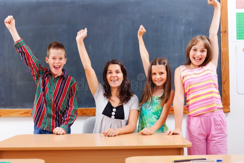 Nauczyciel i ucznie w sala lekcyjnej obrazy royalty free
