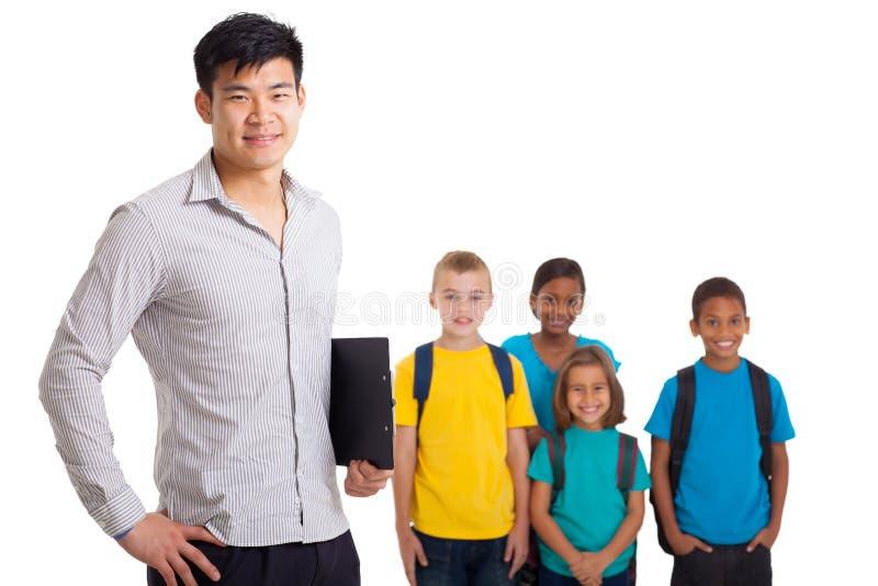 Nauczyciel szkoły dzieciaki fotografia royalty free