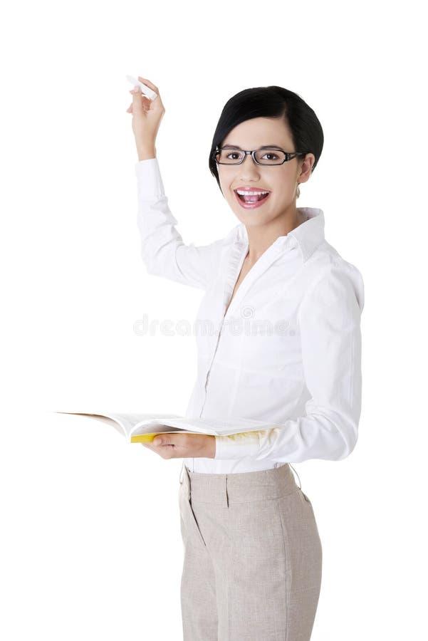 Nauczyciel z książką i kredą obraz royalty free