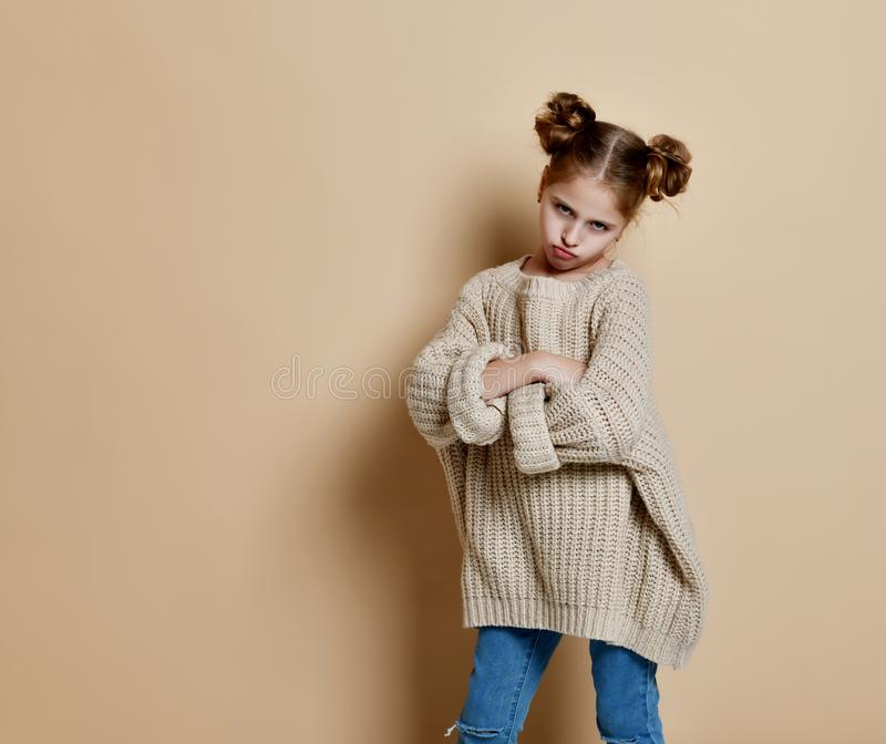 Naughty little girl over the beige background stock images