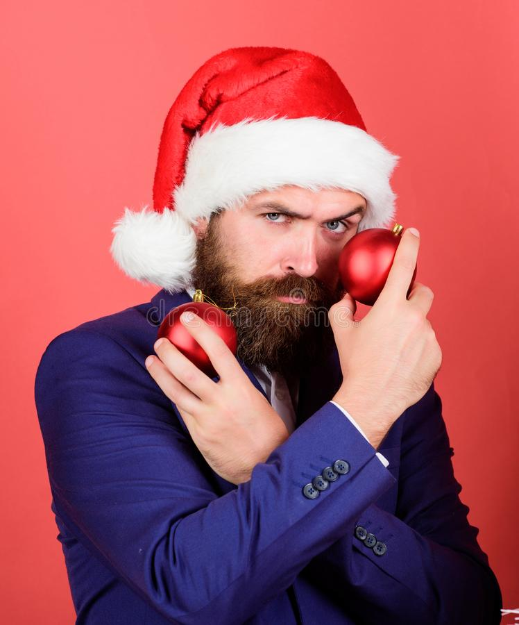 Naughty is new nice. Man with beard hold red balls christmas decorations. Winter holidays. Share christmas mood. Spread royalty free stock photo