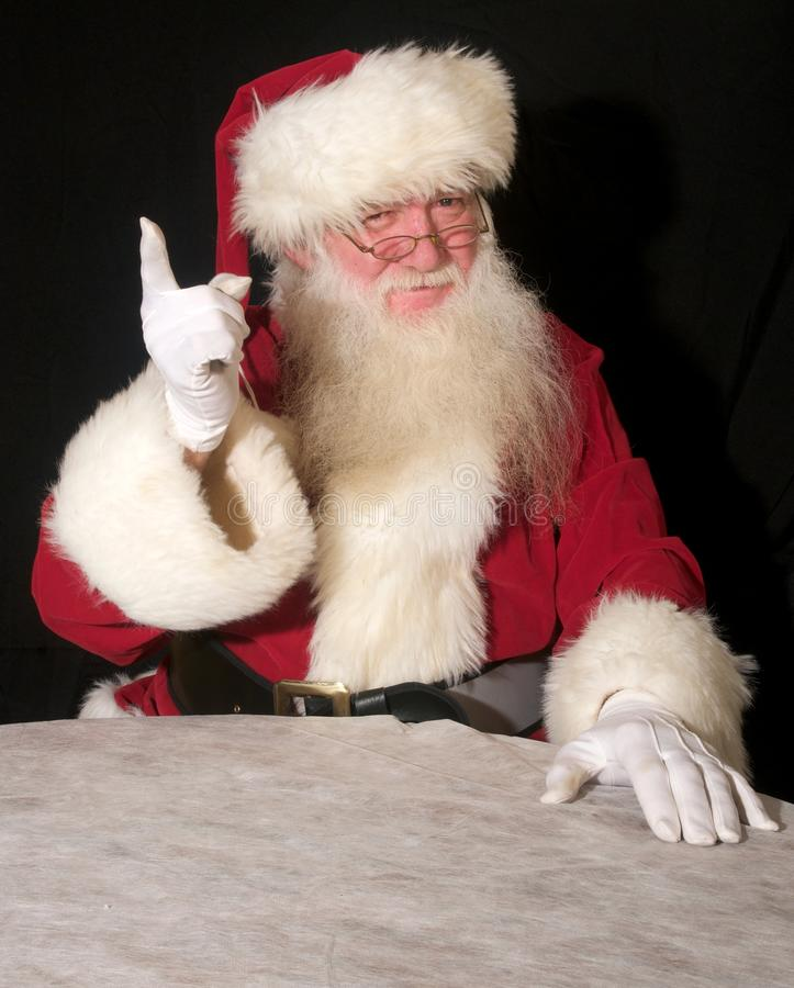Naughty Or Nice Santa Stock Photo