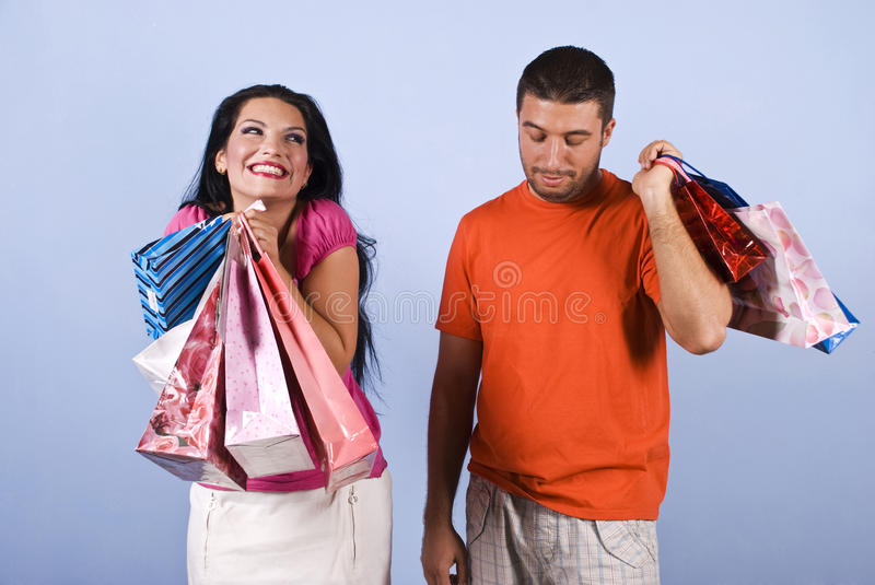 Naughty and vanity woman with shopping bags stock images