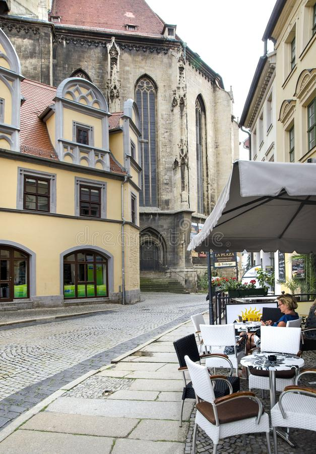 Naumburg, Germany, August 07, 2019 - an outdoor cafe on the street next to Naumburg Cathedral. Naumburg, Germany, August 07, 2019 - summer cafe on an old street royalty free stock photography