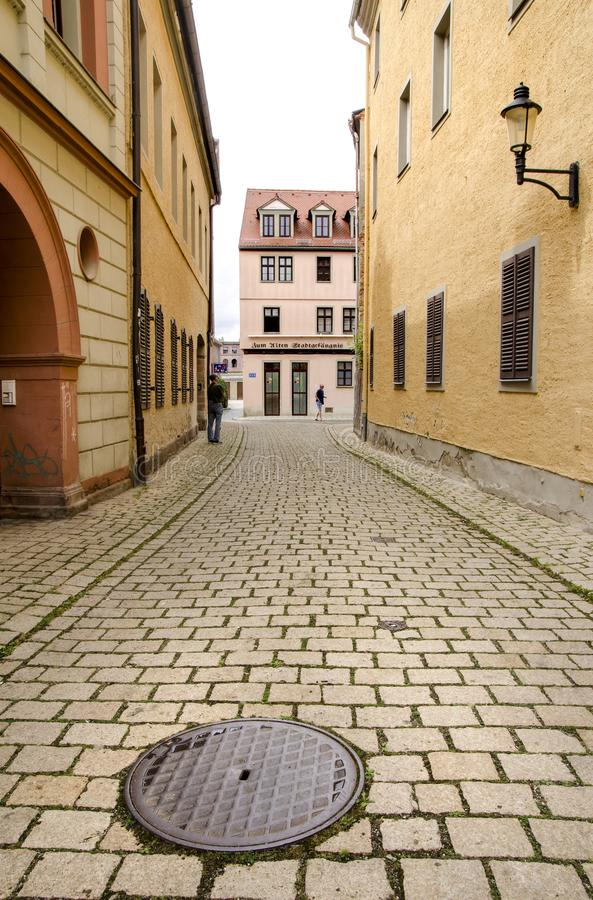 Naumburg, Germany, 07 August 2019 - a quiet cobblestone street with beautiful old houses. Naumburg, Germany, August 07, 2019 - a street with beautiful old houses royalty free stock image