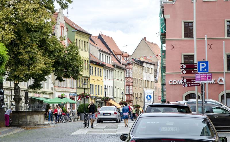 Naumburg, Germany, 08/07/2018 - A beautiful old medieval street in a small town. Naumburg, Germany, 08/07/2018 - People on a beautiful old medieval street in a stock image