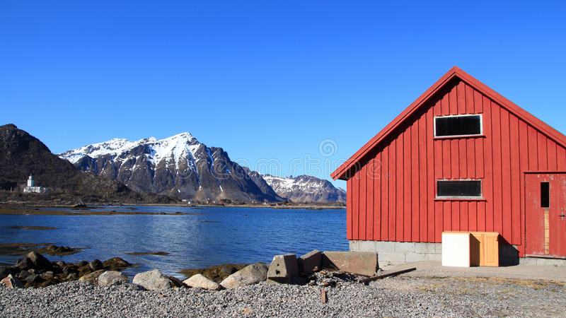 Naustet and church of Stamsund. Boat house and church of the small village of Stamsund in Lofoten stock image