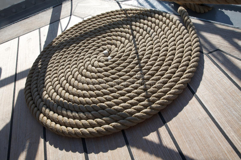 Nautical. The braided mooring rope on a ship deck stock images