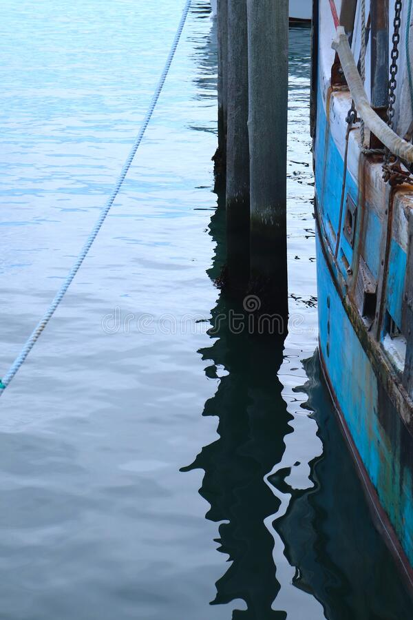 Free Nautical Abstract Of Dock, With Rope, Water, Pier, Blue Boat Stock Images - 169094054