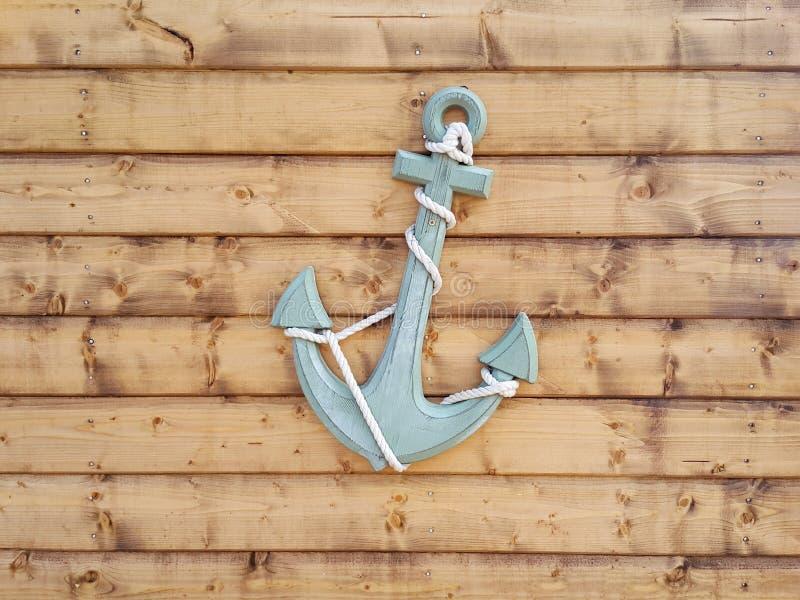 Nautical Anchor on Brown Wood Panel Wall stock photo