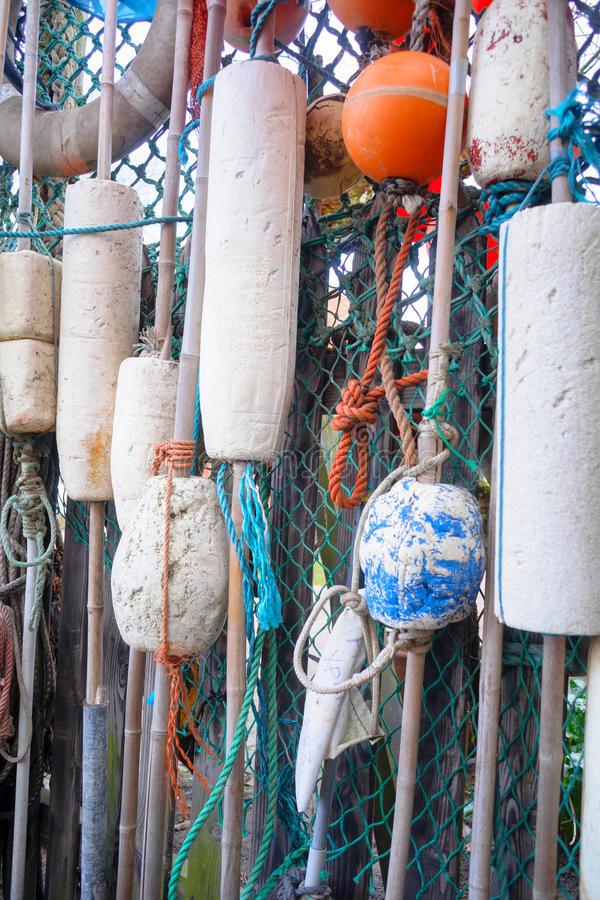 Nautical background. Closeup of old colorful mooring ropes , Old. Closeup of old colorful mooring ropes , Old buoys and fishing gear at the island Texel royalty free stock photo